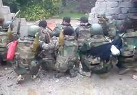 Syyrialaiset sotilaat juhlivat taistelun voittoa
